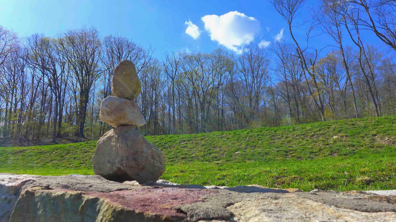 Stone mandala on stone fence