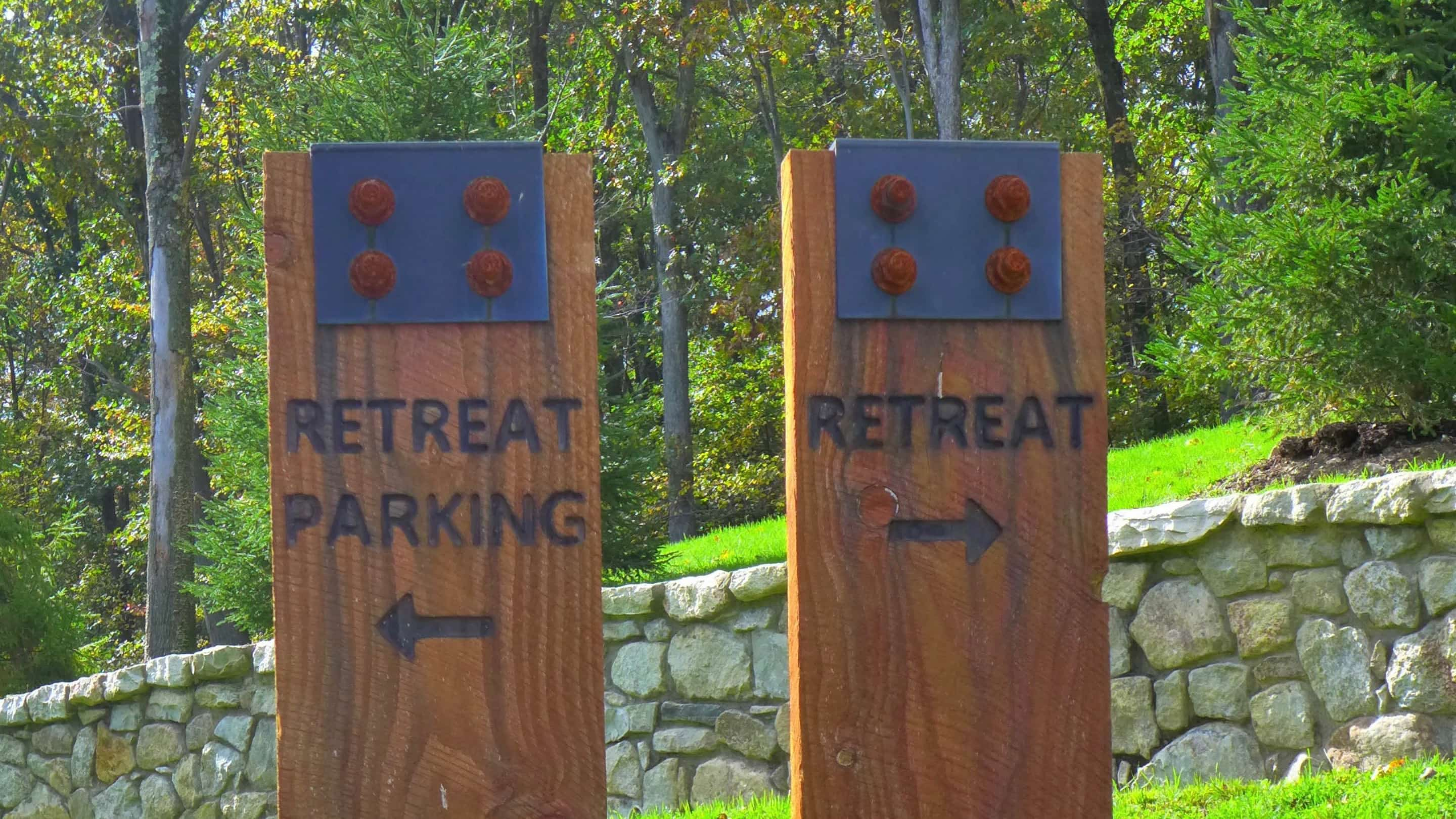 two signs: retreat and retreat parking